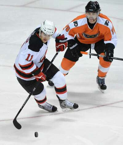 Devils' #11 Bobby Butler ,left, and Adirondack's Adirondack Phantom's #9 Rob Bordson during Saturday night's game at the Times Union Center in Albany Nov. 10, 2012.  (John Carl D'Annibale / Times Union) Photo: John Carl D'Annibale / 00020057A
