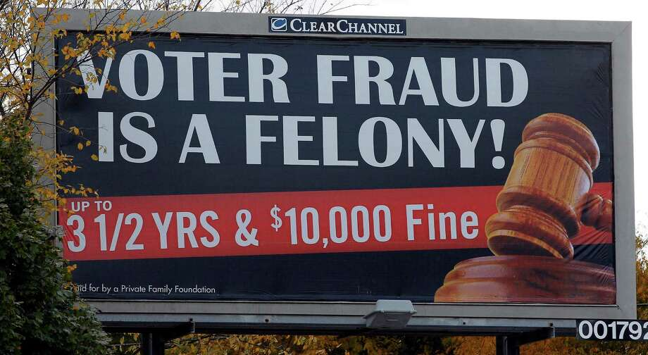 This billboard in a predominantly black area of Milwaukee was one of many that were seen as trying to scare African-Americans away from the polls. Photo: Mark Hoffman, Staff Photographer / 30069087A
