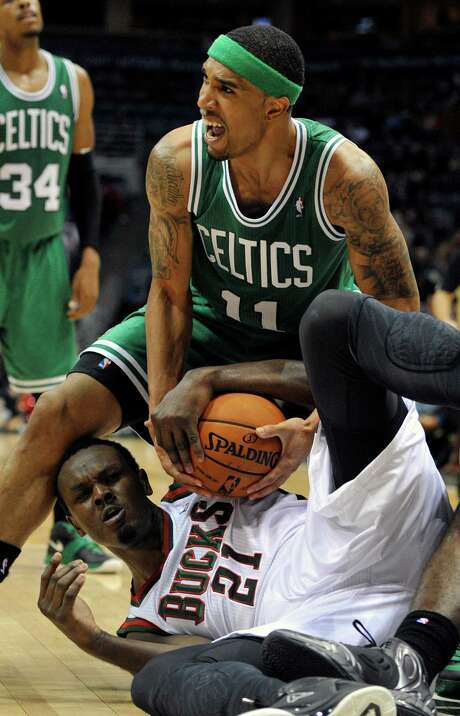 Boston's Courtney Lee (11) and Milwaukee's Samuel Dalembert battle for the ball in the Celtics' 96-92 win Saturday. Photo: Jim Prisching, FRE / FR59933 AP