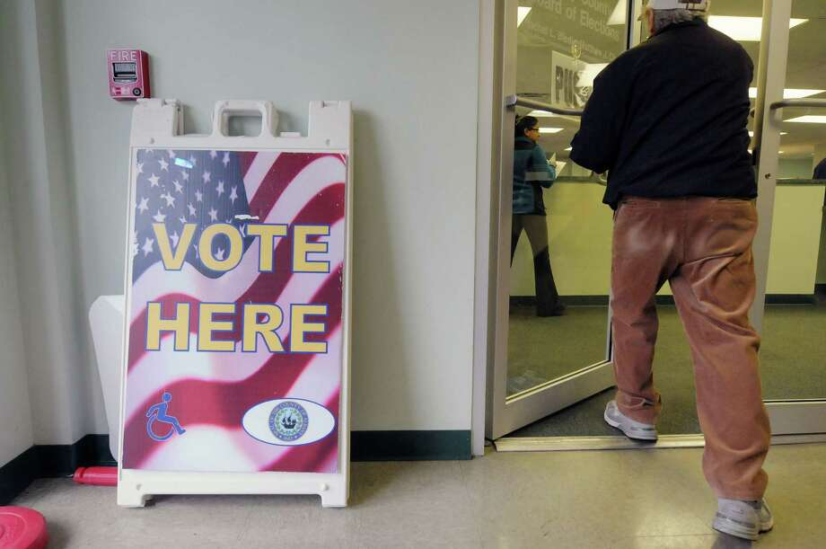 A voter makes his way into the Albany County Board of Elections on Monday, Nov. 5, 2012 in Albany, NY.  On Monday voters who would not be able to vote on election day could come into the board of elections and cast an absentee ballot.    (Paul Buckowski / Times Union) Photo: Paul Buckowski  / 00019954A