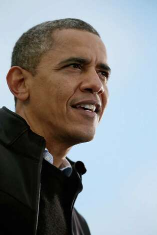 MADISON, WI - NOVEMBER 05:  U.S. President Barack Obama addresses a rally during the last day of campaigning in the general election November 5, 2012 in Madison, Wisconsin. Obama and his opponent, Republican presidential nominee and former Massachusetts Gov. Mitt Romney are stumping from one 'swing state' to the next in a last-minute rush to persuade undecided voters.  (Photo by Chip Somodevilla/Getty Images) Photo: Chip Somodevilla / 2012 Getty Images