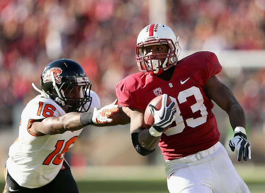 STANFORD, CA - NOVEMBER 10: Stepfan Taylor #33 of the Stanford Cardinal gets away from Rashaad Reynolds #16 of the Oregon State Beavers on his way to scoring a touchdown at Stanford Stadium on November 10, 2012 in Stanford, California.  (Photo by Ezra Shaw/Getty Images) Photo: Ezra Shaw, Getty Images