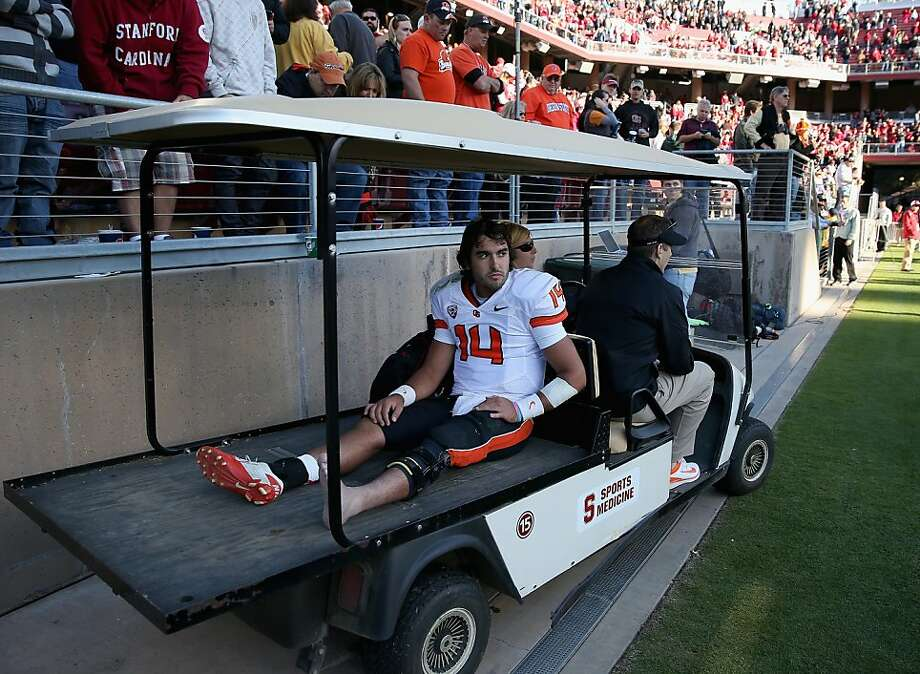 STANFORD, CA - NOVEMBER 10:  Cody Vaz #14 of the Oregon State Beavers leaves the field on a cart after their loss to the Stanford Cardinal  at Stanford Stadium on November 10, 2012 in Stanford, California.  (Photo by Ezra Shaw/Getty Images) Photo: Ezra Shaw, Getty Images