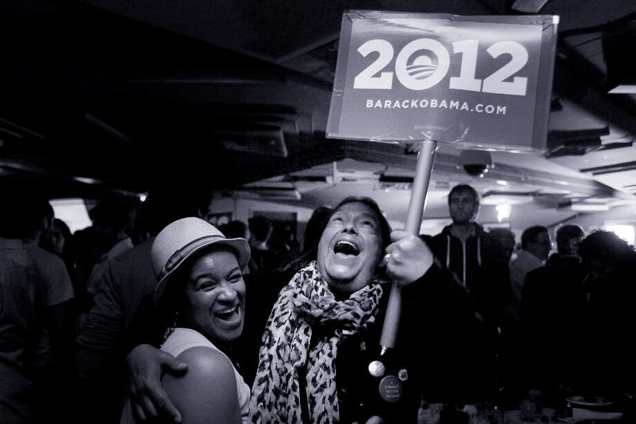 At an election party for the Democratic Party in San Francisco,  Gabriel Ortega and Leah Pimentel hug for joy after President Barack Obama wins a second a second term on Tuesday Nov. 6, 2012 in San Francisco, Calif. Photo: Mike Kepka, The Chronicle / ONLINE_YES