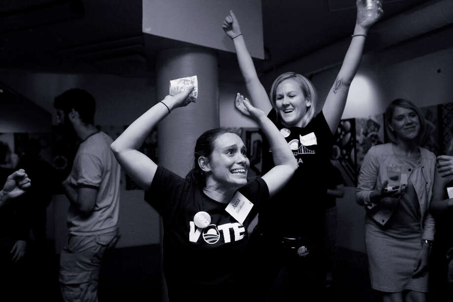 At an election party for the Democratic Party in San Francisco, Anna Abramson and Ashley Hanson hit the dance floor after President Barack Obama wins a second a second term on Tuesday Nov. 6, 2012 in San Francisco, Calif. Photo: Mike Kepka, The Chronicle / ONLINE_YES