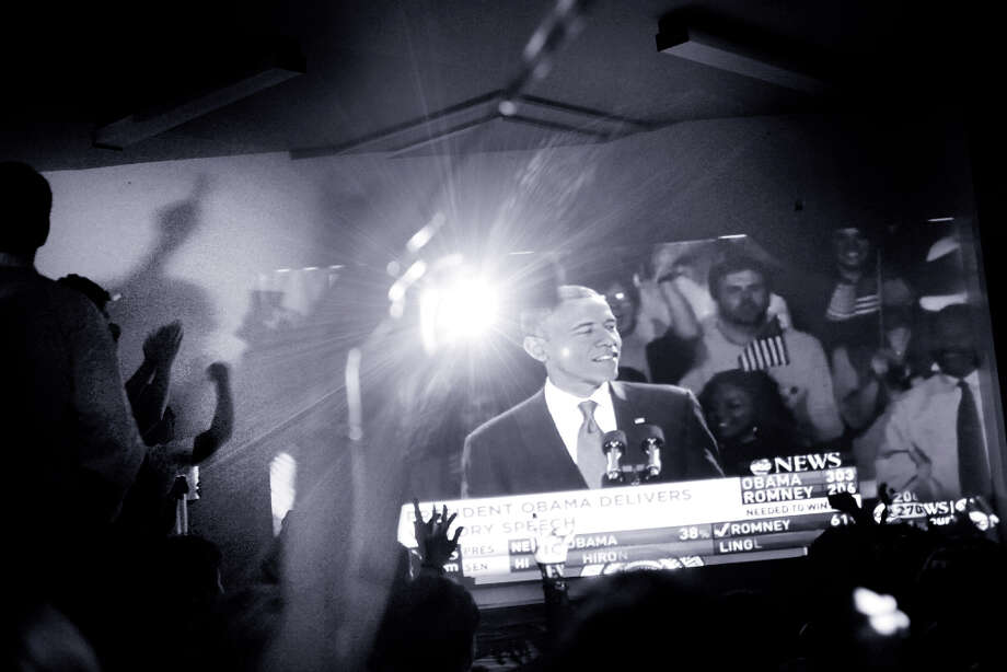 At an election party for the Democratic Party in San Francisco,  a crowd of Obama supporters watch as President Barack Obama gives his victory speech on Tuesday Nov. 6, 2012 in San Francisco, Calif. (Mike Kepka / The Chronicle)