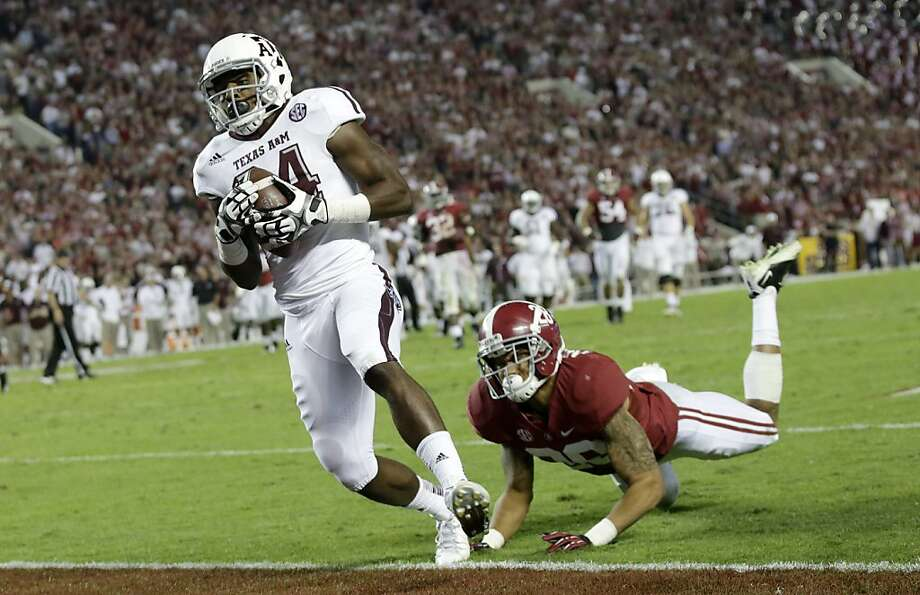 Texas A&M wide receiver Malcome Kennedy (84) catches the game winning touchdown as Alabama defensive back Dee Milliner (28) defends during the second half of an NCAA college football game at Bryant-Denny Stadium in Tuscaloosa, Ala., Saturday, Nov. 10, 2012. (AP Photo/Dave Martin) Photo: Dave Martin, Associated Press