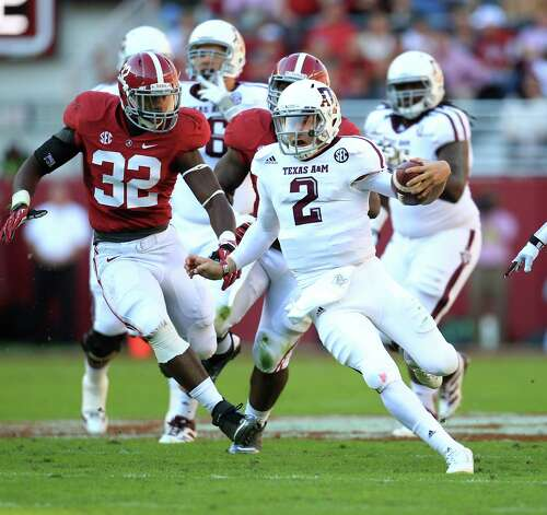A&M quarterback Johnny Manziel performs his trademark scrambling, with Alabama's C.J. Mosley in pursuit. Photo: Karen Warren, Staff / © 2012  Houston Chronicle
