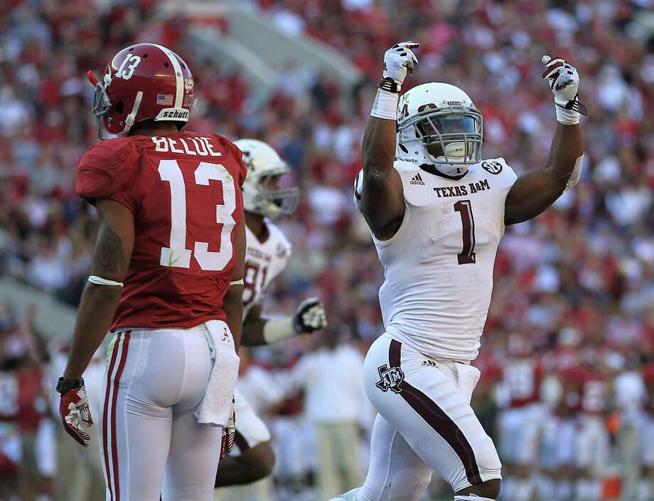Ben Malena celebrates during a first quarter in which A&M soared to a 20-0 lead. Photo: Karen Warren, Staff / © 2012  Houston Chronicle