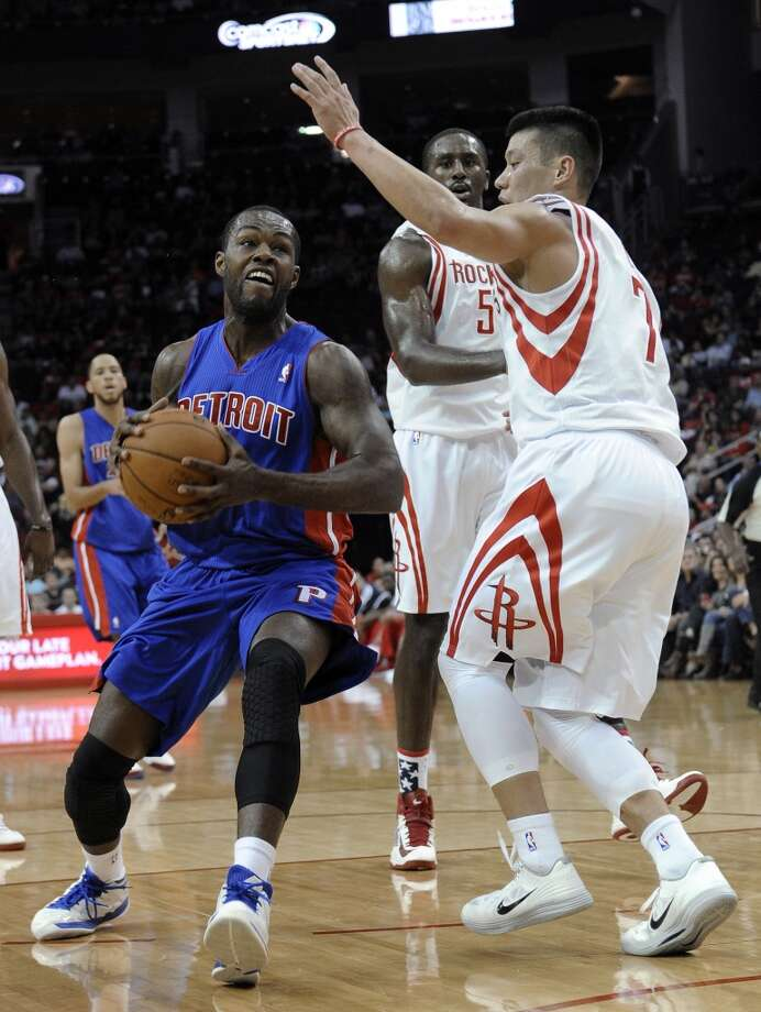 Denver Nuggets' Ty Lawson, left, goes to the basket guarded while by Houston Rockets' Jeremy Lin (7) and Patrick Patterson (54) in the first half. (Pat Sullivan / Associated Press)