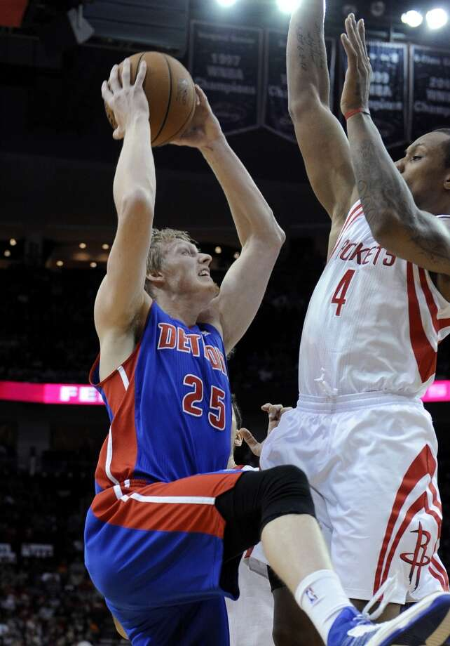 Detroit Pistons' Kyle Singler (25) goes up against Houston Rockets' Greg Smith (4) in the first half. (Pat Sullivan / Associated Press)
