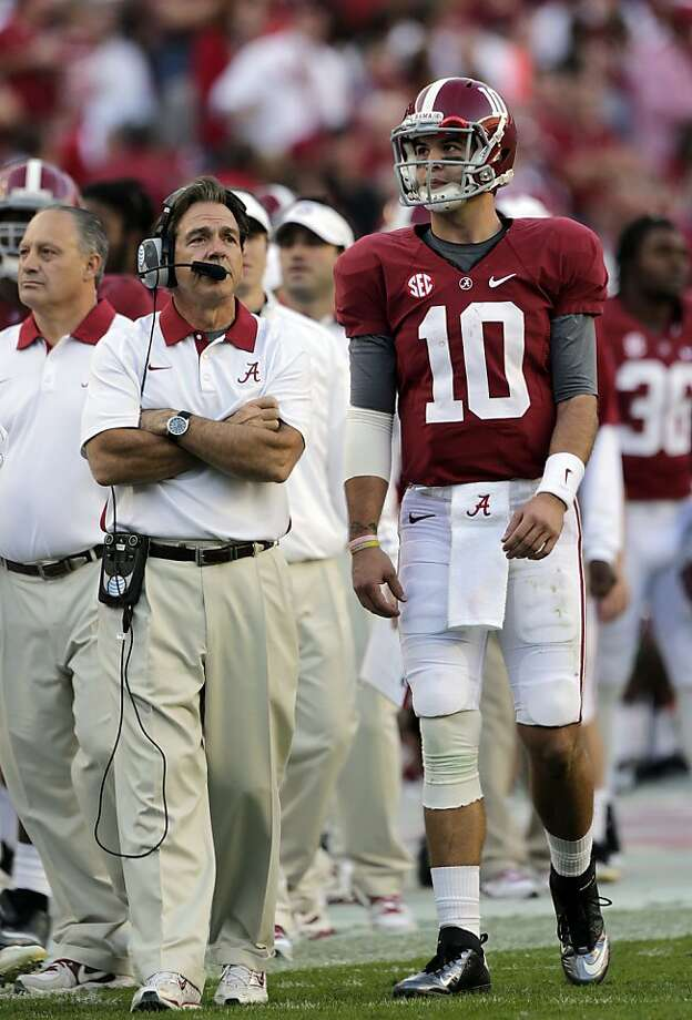 Alabama coach Nick Saban talks with quarterback AJ McCarron during the first half of an NCAA college football game at Bryant-Denny Stadium in Tuscaloosa, Ala., Saturday, Nov. 10, 2012. (AP Photo/Dave Martin) Photo: Dave Martin, Associated Press