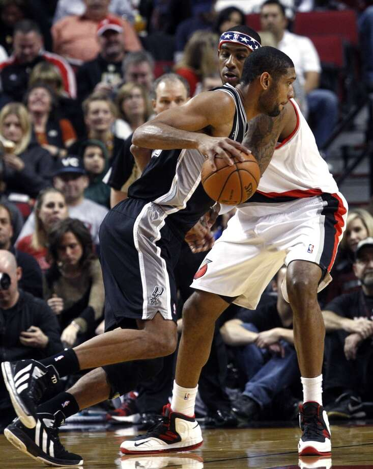 San Antonio Spurs forward Tim Duncan, left, drives on Portland Trail Blazers forward LaMarcus Aldridge during the first half of their NBA basketball game in Portland, Ore., Saturday, Nov. 10, 2012. (AP Photo/Don Ryan) (Associated Press)