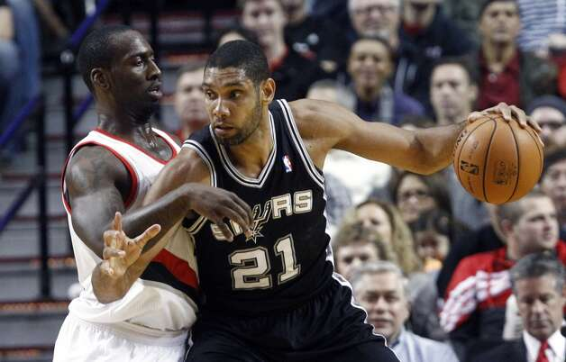 San Antonio Spurs forward Tim Duncan, right, backs in on Portland Trail Blazers center J.J. Hickson during the first half of their NBA basketball game in Portland, Ore., Saturday, Nov. 10, 2012. (AP Photo/Don Ryan) (Associated Press)