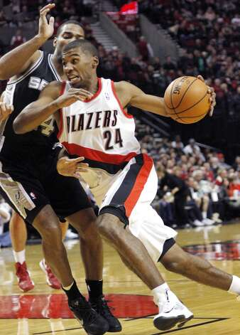 Portland Trail Blazers guard Ronnie Price, right, drives on San Antonio Spurs guard Gary Neal during the first half of their NBA basketball game in Portland, Ore., Saturday, Nov. 10, 2012. (AP Photo/Don Ryan) (Associated Press)