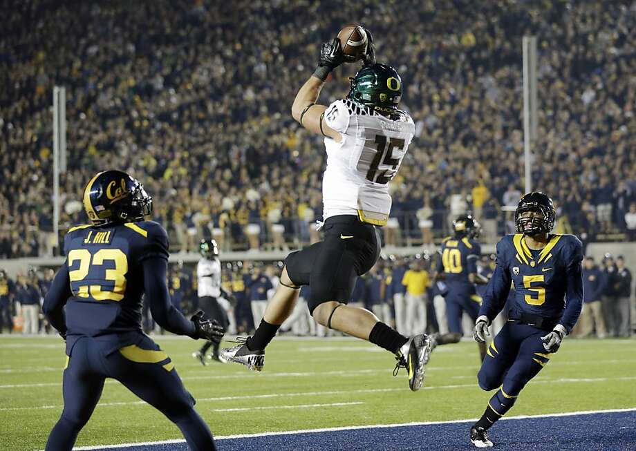Oregon tight end Colt Lyerla (15) grabs a ten yard touchdown pass in front of California defensive back Josh Hill (23) and defensive back Michael Lowe (5) during the first half of an NCAA college football game in Berkeley, Calif., Saturday, Nov. 10, 2012. (AP Photo/Marcio Jose Sanchez) Photo: Marcio Jose Sanchez, Associated Press