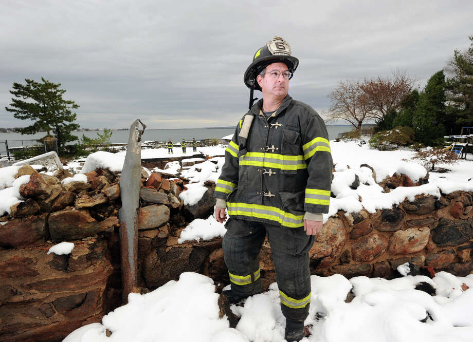 Lt. John Chimblo of the Greenwich Fire Department stands among the ruins of the incinerated watefront mansion at 45 Binney Lane in Old Greenwich, Thursday afternoon, November 8, 2012. Chimblo and four other Greenwich firefighters were the first to arrive on the scene of the fire during the height of Hurricane Sandy. Two other homes on the surrounding property caught fire from the hurricane winds and burned to the ground. Photo: Bob Luckey / Greenwich Time