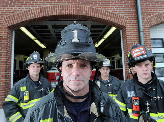 Greenwich Firefighter Steve Lanzarone, foreground, and fellow firefighters, from left, Shawn Murphy, Lt. John Chimblo and Adam Jakubowski in front of the Sound Beach Fire House in Old Greenwich, Thursday afternoon, November 8, 2012. These Greenwich firefighters were the first to arrive on the scene of the waterfront mansion fire at 45 Binney Lane in Old Greenwich during the height of Hurricane Sandy. Two other homes on the surrounding property caught fire from the hurricane winds and burned to the ground. Photo: Bob Luckey / Greenwich Time