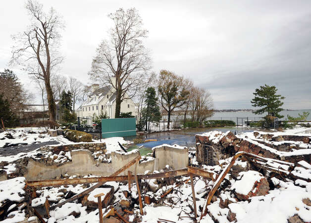 The ruins of the watefront mansion at 45 Binney Lane in Old Greenwich, Thursday afternoon, November 8, 2012. The home along with two neighboring homes burned to the ground during Hurricane Sandy. Photo: Bob Luckey / Greenwich Time