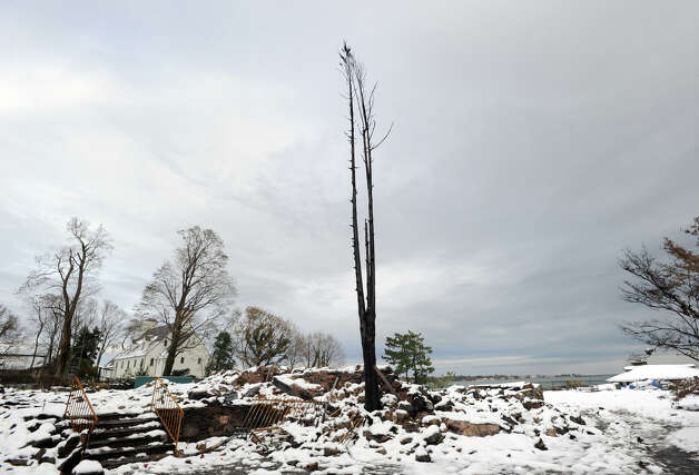A charred tree and rubble are all that remain of the watefront mansion at 45 Binney Lane in Old Greenwich, Thursday afternoon, November 8, 2012. The home along with two neighboring homes burned to the ground during Hurricane Sandy. Photo: Bob Luckey / Greenwich Time