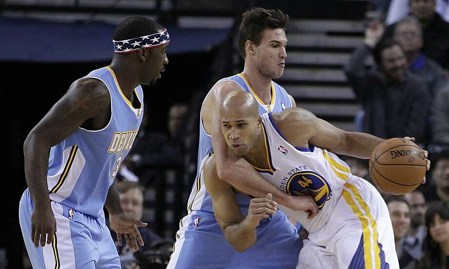 Golden State Warriors' Richard Jefferson, right, drives the ball against Denver Nuggets' Danilo Gallinari and Ty Lawson (3) during the first half of an NBA basketball game Saturday, Nov. 10, 2012, in Oakland, Calif. (AP Photo/Ben Margot) Photo: Ben Margot, Associated Press
