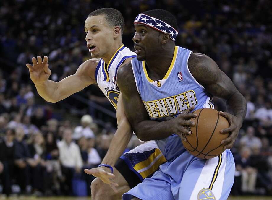 Denver Nuggets' Ty Lawson, right, drives the ball against Golden State Warriors' Stephen Curry during the first half of an NBA basketball game on Saturday, Nov. 10, 2012, in Oakland, Calif. (AP Photo/Ben Margot) Photo: Ben Margot, Associated Press