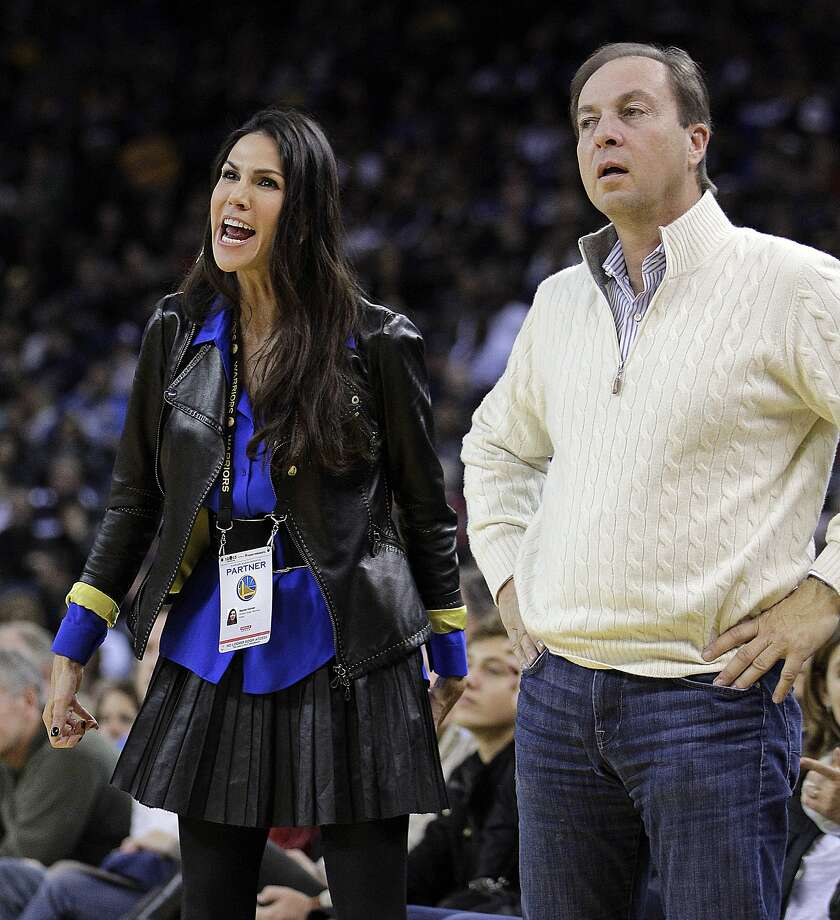 Golden State Warriors co-owner Joe Lacob and his fiance Nicole Curran react after a call against the Warriors during the first half of an NBA basketball game against the Denver Nuggets Saturday, Nov. 10, 2012, in Oakland, Calif. (AP Photo/Ben Margot) Photo: Ben Margot, Associated Press