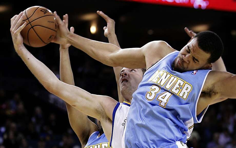 Denver Nuggets' JaVale McGee (34) blocks the shot of Golden State Warriors' David Lee during the first half of an NBA basketball game Saturday, Nov. 10, 2012, in Oakland, Calif. (AP Photo/Ben Margot) Photo: Ben Margot, Associated Press