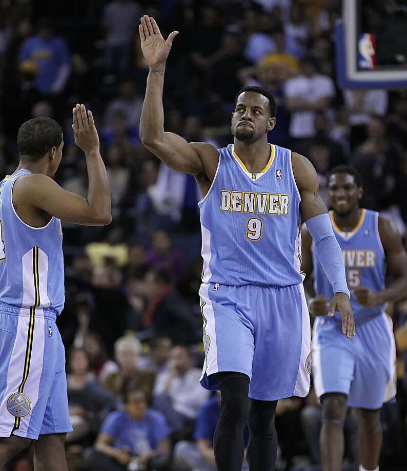 Denver Nuggets' Andre Iguodala (9)celebrates with Andre Miller, left, during double overtime in an NBA basketball game against the Golden State Warriors Saturday, Nov. 10, 2012, in Oakland, Calif. (AP Photo/Ben Margot) Photo: Ben Margot, Associated Press