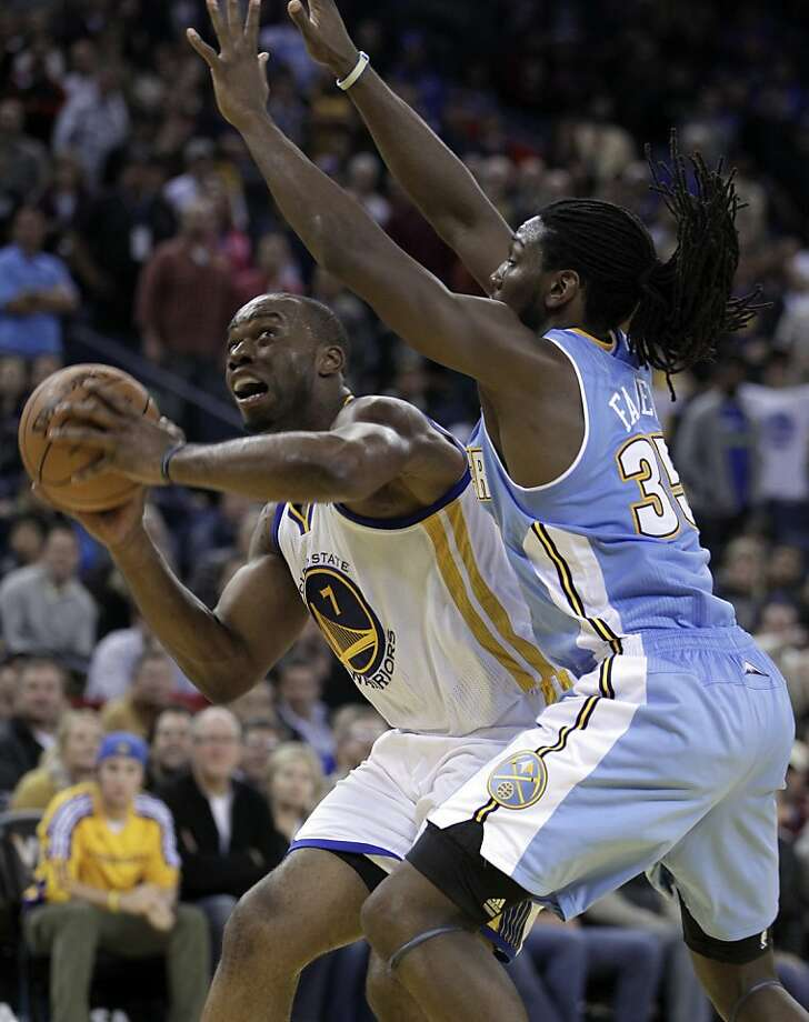 Golden State Warriors' Carl Landry, left, looks for a way around Denver Nuggets' Kenneth Faried (35) during overtime in an NBA basketball game Saturday, Nov. 10, 2012, in Oakland, Calif. (AP Photo/Ben Margot) Photo: Ben Margot, Associated Press