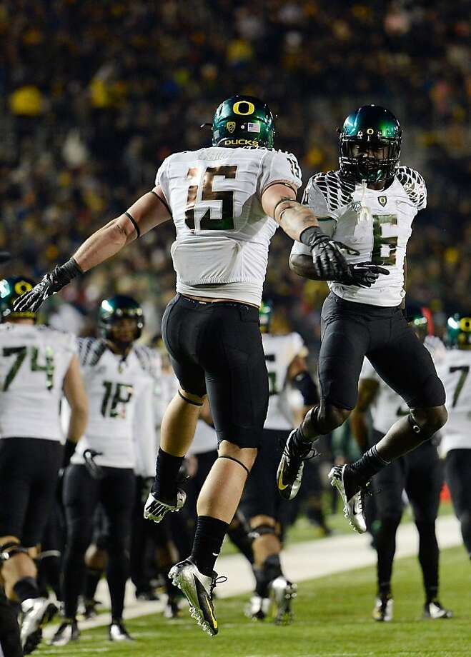 BERKELEY, CA - NOVEMBER 10:  Colt Lyeria #15 and De'Anthony Thomas #6 of the Oregon Ducks celebrates after Lyeria caught a ten-yard touchdown pass against the California Golden Bears in the first quarter of an NCAA College football game at California Memorial Stadium on November 10, 2012 in Berkeley, California.  (Photo by Thearon W. Henderson/Getty Images) Photo: Thearon W. Henderson, Getty Images