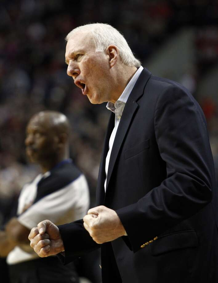 San Antonio Spurs basketball coach Gregg Popovitch reacts after his team scores during the second half of their NBA basketball game against the Portland Trail Blazers in Portland, Ore., Saturday, Nov. 10, 2012.  The Spurs won 112-90.(AP Photo/Don Ryan) (Associated Press)