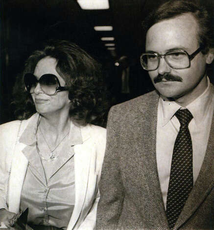 Theresa Brown charged with operating a brothel in San Antonio in 1980 walks with her attorney and Pat Maloney Jr. Photo: San Antonio Express-News