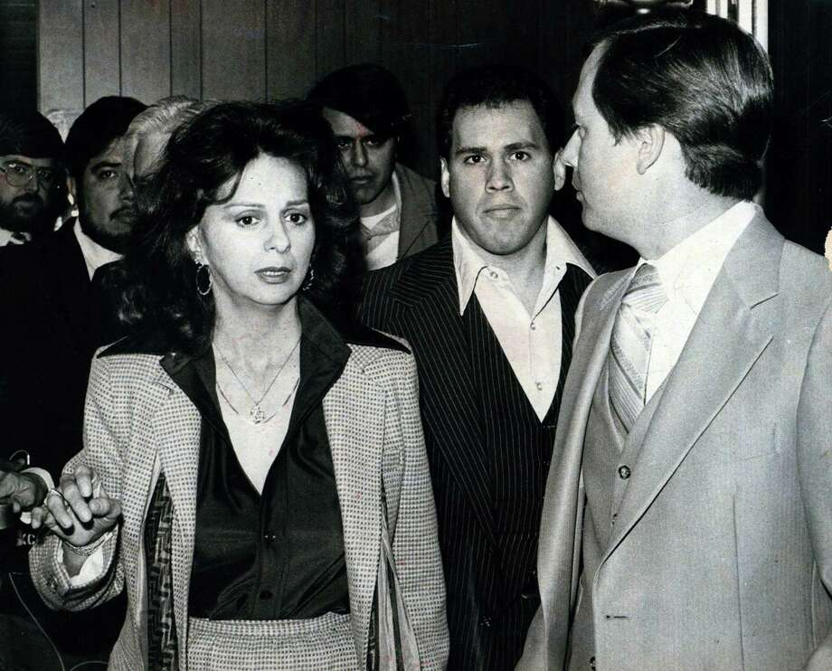 Theresa Brown was charged with operating a brothel in San Antonio in 1980, but one source says police knew of her business years earlier. Here, Brown and her son, Cecil Brown, walk with attorney Rick Woods. Photo: Express-News File Photo
