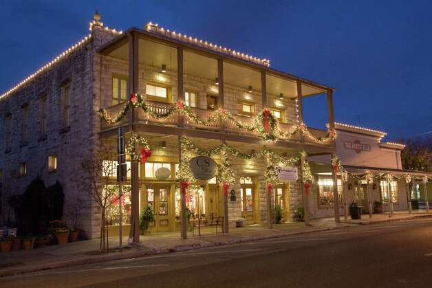 Traditional holiday decorations on the historic buildings downtown Fredericksburg help give the Christmas celebration a German flavor. Photo: Trish McCabe-Rawls/Fredericksbur, Courtesy Photo