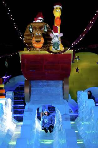"""Merry Madagascar"" is the theme for the Gaylord Texan Resort's ""ICE!"" attraction carved from two million pounds of ice. It's one of many attractions in the city declared the Christmas Capital of Texas and boasting of more than 1,400 events. Photo: Courtesy Photo / All rights reserved"