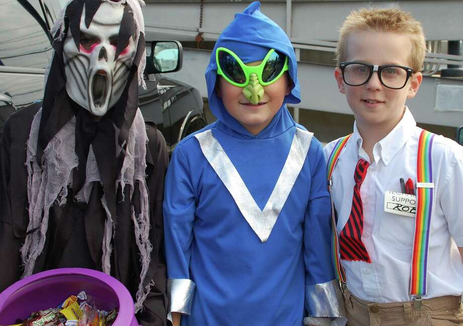 Three Amigos -- Halloween style! In the big crowd of trick-or-treaters Saturday at the Fairfield Railroad Station were, from left, William McCarmack, 9; Oliver Kwon, 9, and Craig Wesoloski, 10, all of Fairfield.  Fairfield CT 11/10/12 Photo: Jarret Liotta / Fairfield Citizen contributed