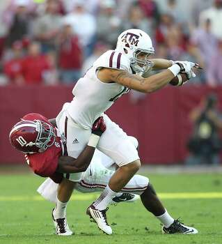 Texas A&M wide receiver Mike Evans (13) makes a catch as Alabama defensive back John Fulton (10) tries to bring him down during the second quarter of a college football game at Bryant-Denny Stadium, Saturday, Nov. 10, 2012, in Tuscaloosa. Photo: Karen Warren, Houston Chronicle / © 2012  Houston Chronicle