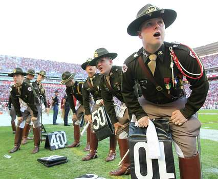 Texas A&M cadets prepare for half time as they participate in a cheer during the second quarter of a college football game at Bryant-Denny Stadium, Saturday, Nov. 10, 2012, in Tuscaloosa. Photo: Karen Warren, Houston Chronicle / © 2012  Houston Chronicle