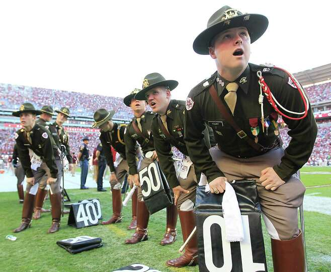 Texas A&M cadets prepare for half time as they participate in a cheer during the second quarter of a