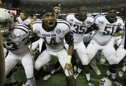 Texas A&M players sing the Aggie War Hymm as they celebrate after beating Alabama during a college football game at Bryant-Denny Stadium, Saturday, Nov. 10, 2012, in Tuscaloosa. Photo: Karen Warren, Houston Chronicle / © 2012  Houston Chronicle
