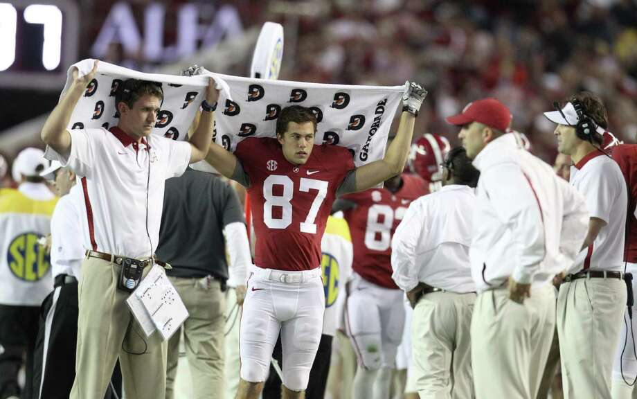 Alabama wide receiver Parker Barrineau (87) and a coach try to shield as a play is called from the sidelines during the second half of a college football game at Bryant-Denny Stadium, Saturday, Nov. 10, 2012, in Tuscaloosa. Photo: Karen Warren, Houston Chronicle / © 2012  Houston Chronicle