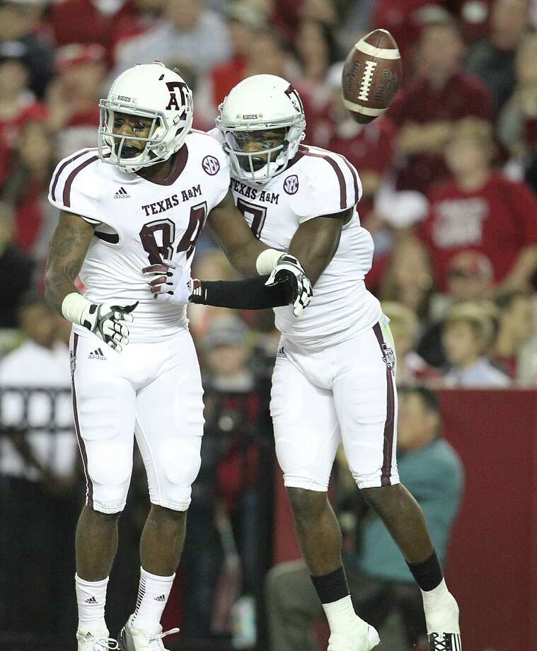 Texas A&M wide receiver Malcome Kennedy (84) reacts to his touchdown with teammate Texas A&M wide receiver Uzoma Nwachukwu (7) during the second half of a college football game at Bryant-Denny Stadium, Saturday, Nov. 10, 2012, in Tuscaloosa. Photo: Karen Warren, Houston Chronicle / © 2012  Houston Chronicle