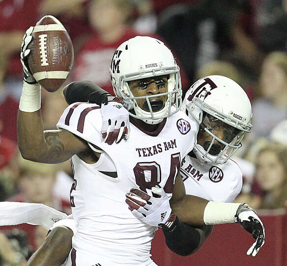 Texas A&M wide receiver Malcome Kennedy (84) reacts to his touchdown with teammate Texas A&M wide re
