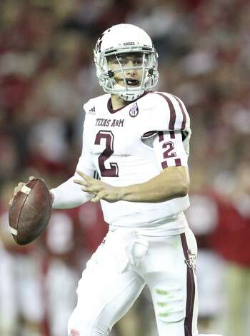 Texas A&M quarterback Johnny Manziel (2) drops back to throw during the second half of a college football game at Bryant-Denny Stadium, Saturday, Nov. 10, 2012, in Tuscaloosa. Photo: Karen Warren, Houston Chronicle / © 2012  Houston Chronicle