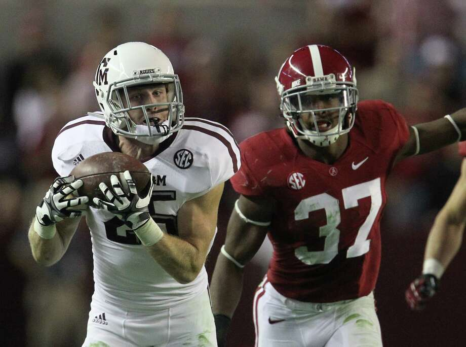 Texas A&M wide receiver Ryan Swope (25) catches a pass over Alabama defensive back Robert Lester (37) during the second half of a college football game at Bryant-Denny Stadium, Saturday, Nov. 10, 2012, in Tuscaloosa. Photo: Karen Warren, Houston Chronicle / © 2012  Houston Chronicle