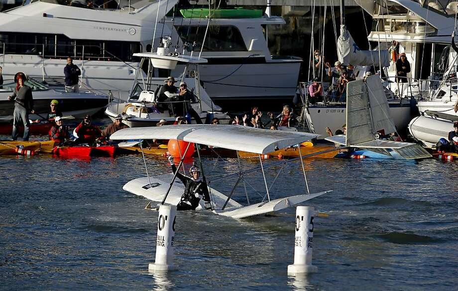Evan Cooper pilot of the Team Flugtag Barons, from Palmdale, Ca., waves to the crowd after his water landing on Saturday Nov. 10, 2012. Flugtag, the outrageous human powered flying competition returns to San Francisco, Calif. after a ten year absence. Photo: Michael Macor, The Chronicle