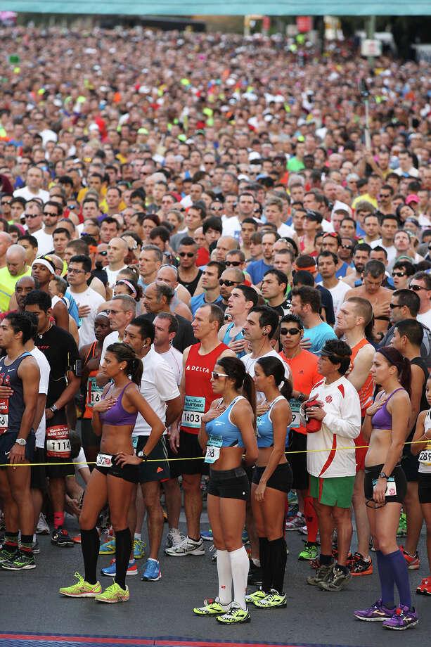 Around 25,000 runners are in place as the National Anthem is sung before the start of the Rock 'n' Roll San Antonio Marathon and 1/2 Marathon, Sunday, Nov. 11, 2012. Photo: Jerry Lara, San Antonio Express-News / © 2012 San Antonio Express-News