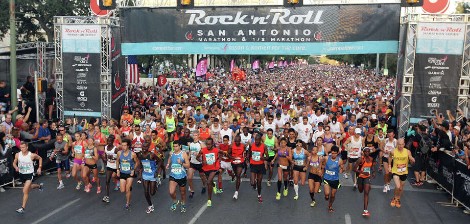 The top group takes off as 25,000 runners participate in the Rock 'n' Roll San Antonio Marathon and 1/2 Marathon, Sunday, Nov. 11, 2012. San Antonio's Jose Munoz won the marathon with a time of 2:27:51. Photo: Jerry Lara, Jerry Lara/Express-News / © 2012 San Antonio Express-News