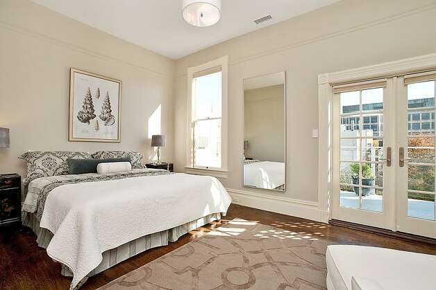 The recently remodeled master suite sits at the rear of the home and overlooks a charming garden. Photo: Open Homes Photography